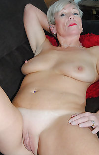 Short haired granny with big nipples Marketa licks and fucks a big toy