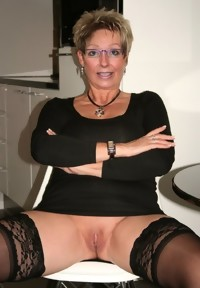 The young guys get their teacher on her knees and they fuck her granny pussy and mouth