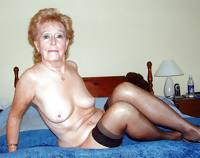 Granny slut showing of her body on her bed